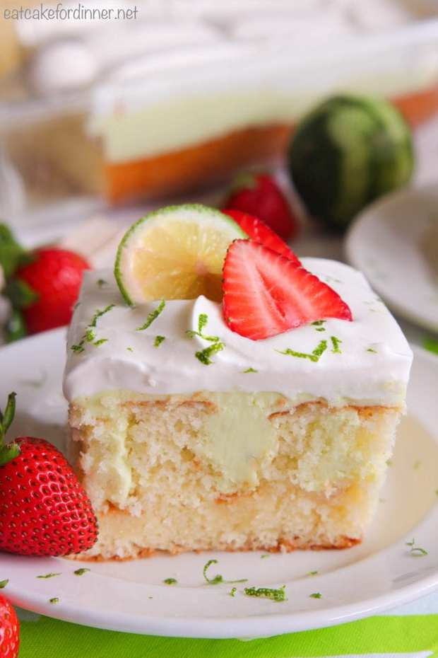 Key Lime Poke Cakeis a delicious white cake that is seeping with a sweet and tart mixture that soaks into the holes. Topped with fresh whipping cream and strawberries this makes a delicious dessert!