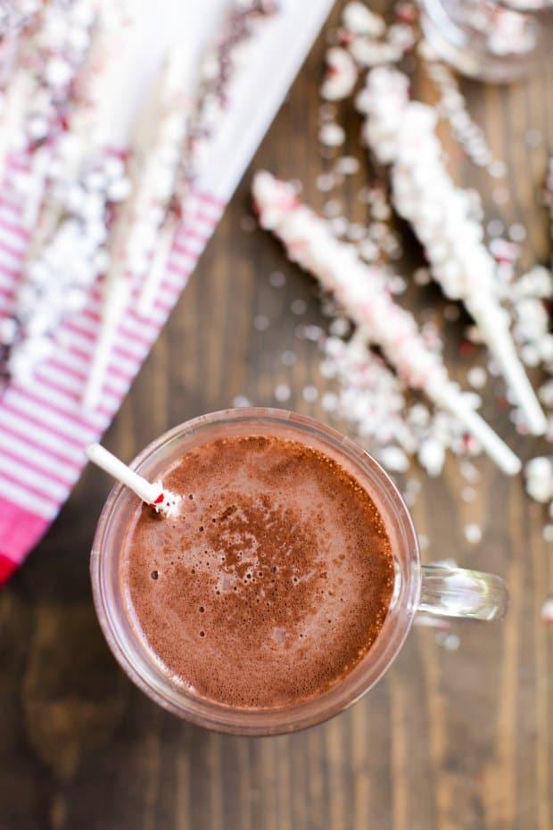 Hot chocolate overhead shot with stir stick melting in mug