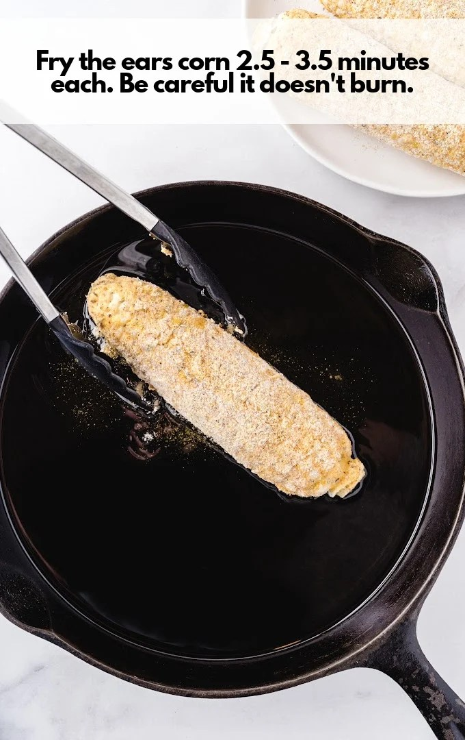 fried coated corn with tongs