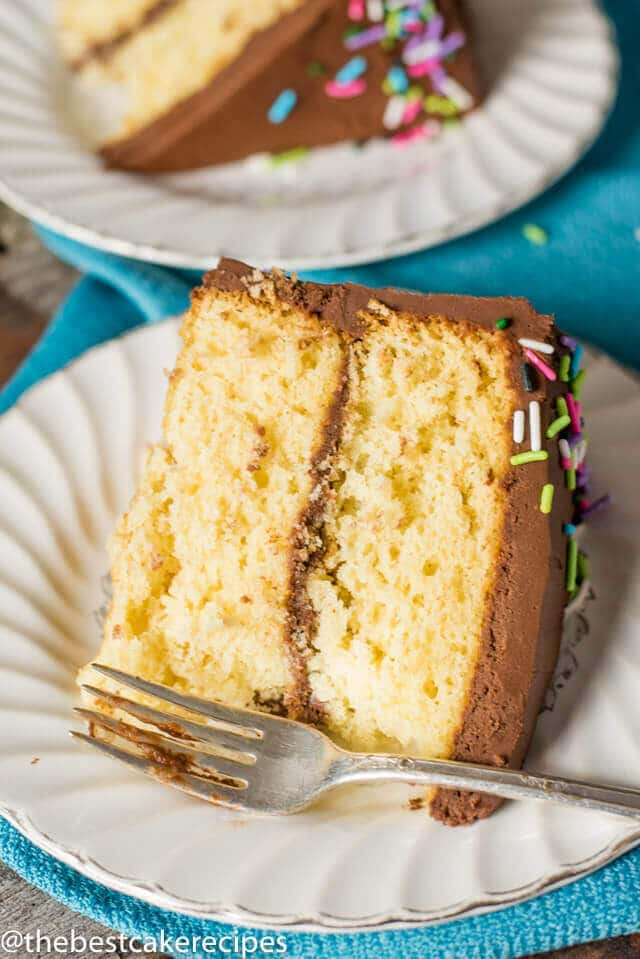 Slice of from scratch yellow cake with chocolate buttercream.