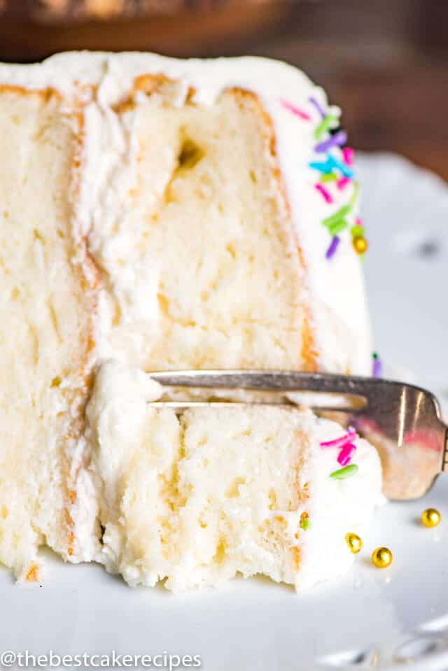 closeup of a gluten free white cake on a plate with a fork