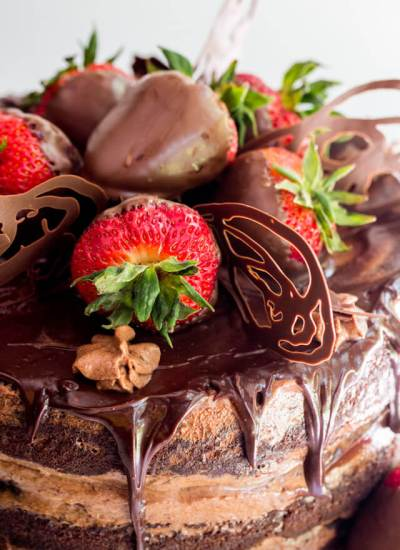 chocolate covered strawberries on a cake