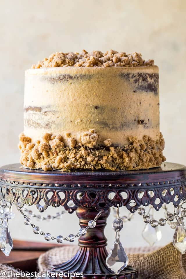 chocolate pumpkin cake with pumpkin spice streusel on a cake stand