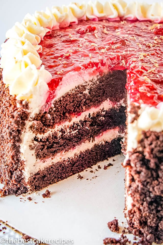 chocolate cake with raspberry filling with one slice missing