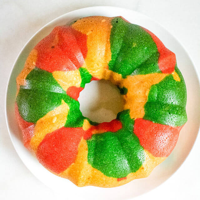 red and green bundt cake  on a cake plate
