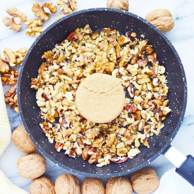 pecans and brown sugar in a skillet