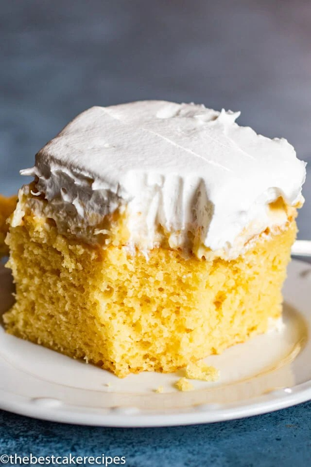 Pineapple Cream Cake on a plate with bite out of it