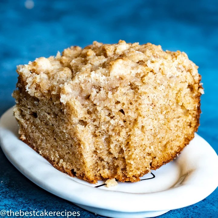 spice crumb cake with bite out on a plate