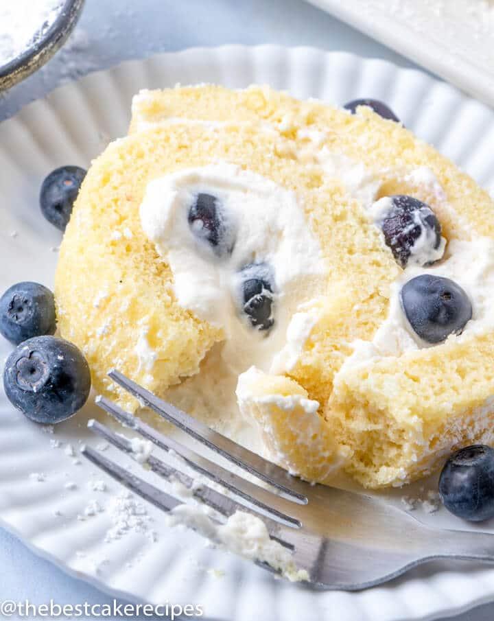 slice of Blueberry Lemon Cake Roll on a plate