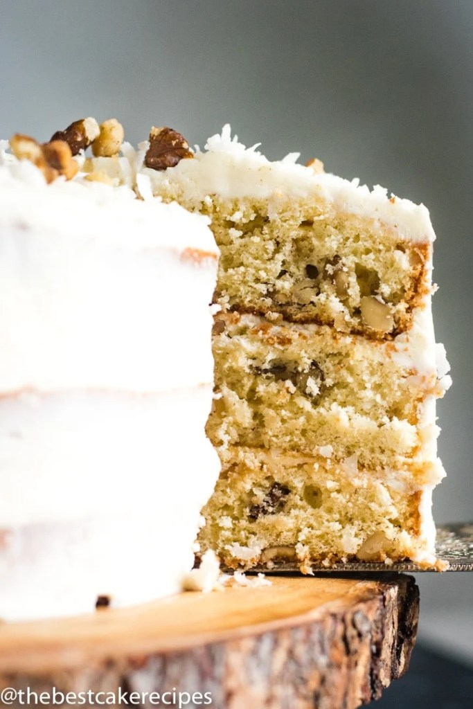 3 layer walnut cake on a spatula