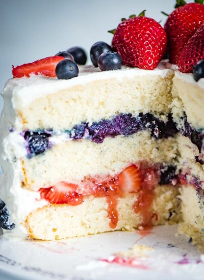 sliced open 3 layer berry cake