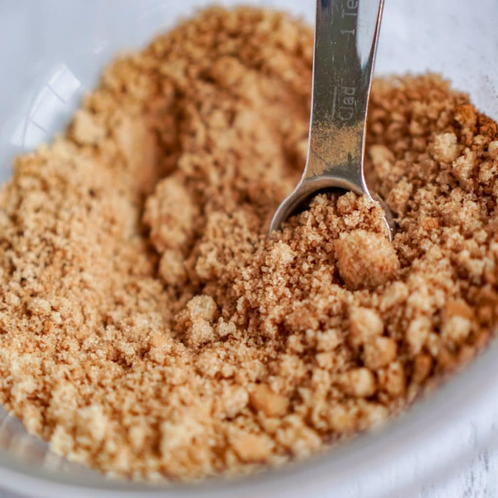 sugar and cinnamon in a bowl with measuring spoon