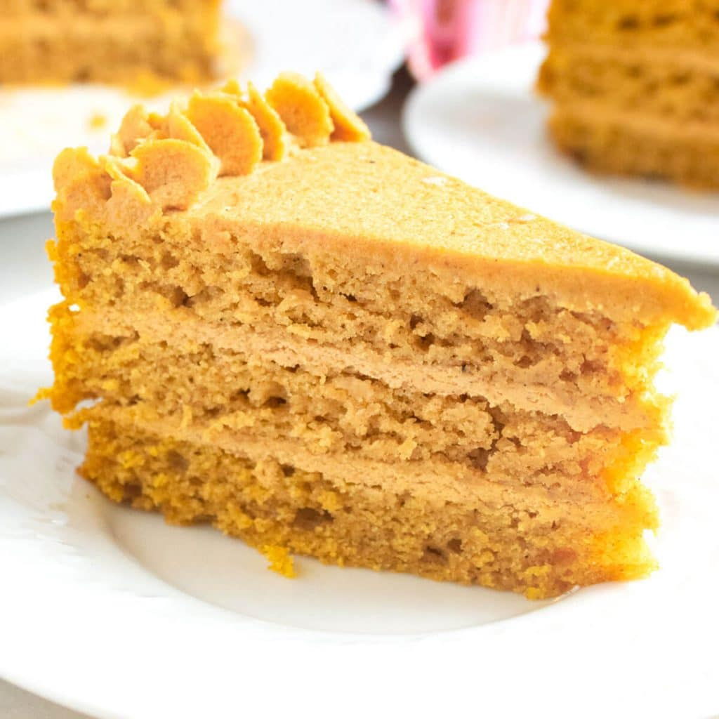 piece of Pumpkin Cake with Pumpkin Ganache on a plate