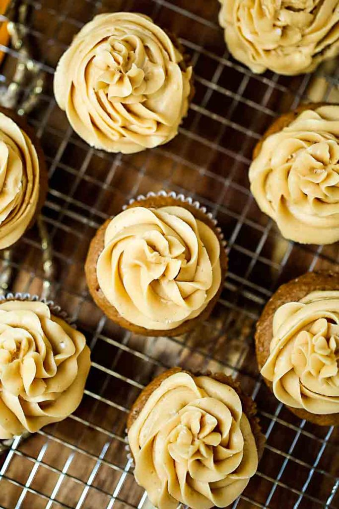 Easy Spice Cupcakes with caramel buttercream on a wire rack