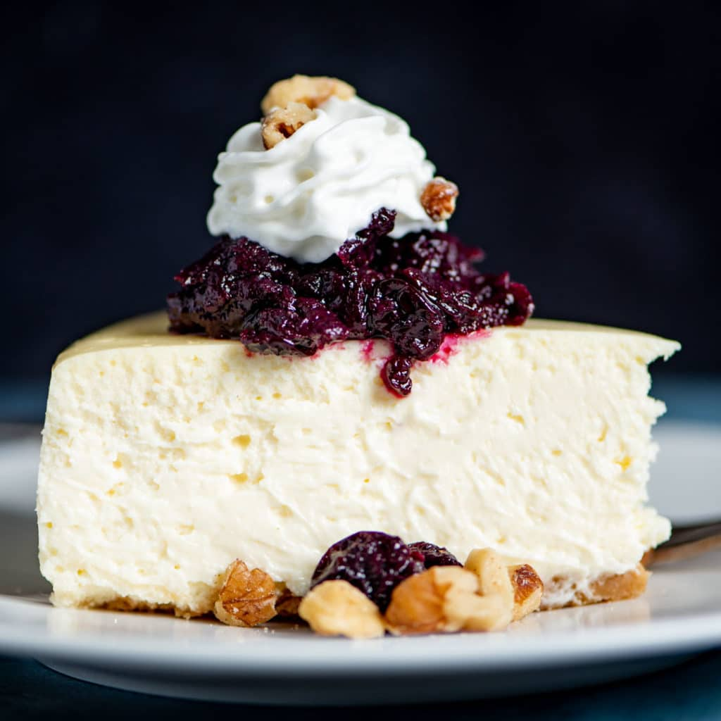 slice of cheesecake on a plate with toppings