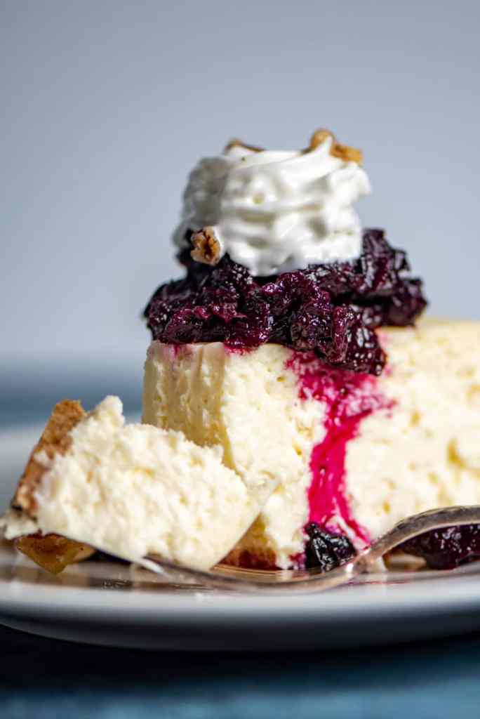 bite of Creamy Cheesecake on a fork