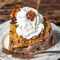 Pecan Raisin Bourbon Cake with whipped cream
