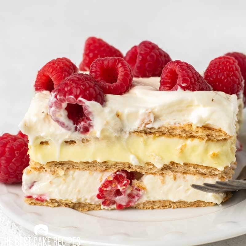 closeup slice of refrigerator cake with pudding and raspberries