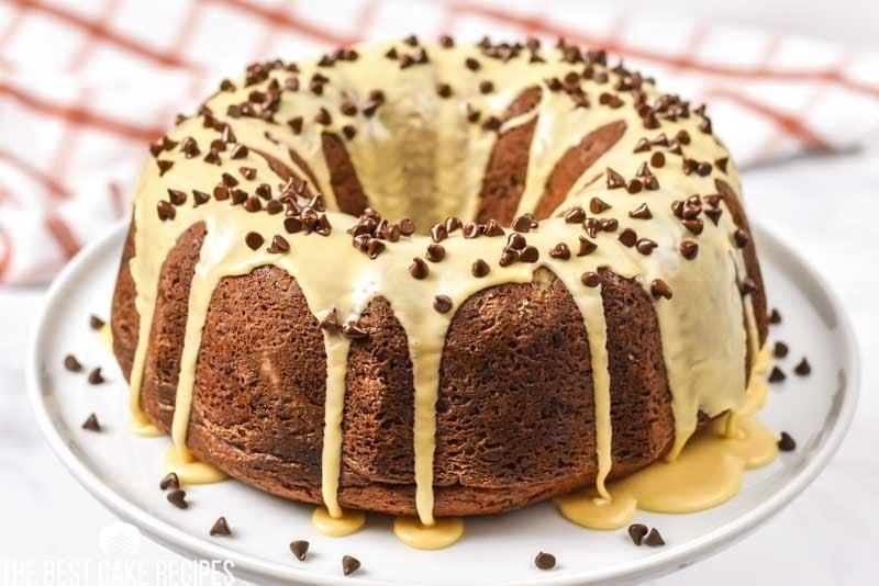 whole chocolate bundt cake on a plate with peanut butter glaze