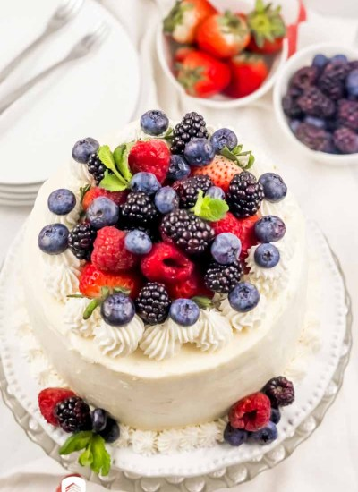 a two layer berry cake on a plate