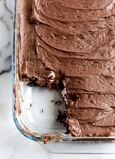 mississippi mud cake in a baking pan with a slice out
