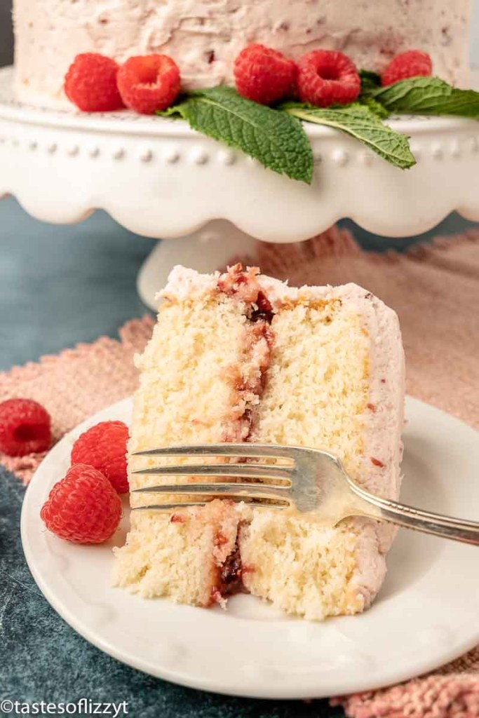 slice of white cake on a plate with a fork