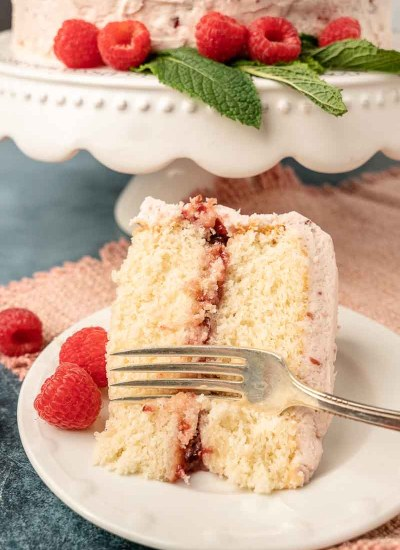 piece white cake on a plate with fork