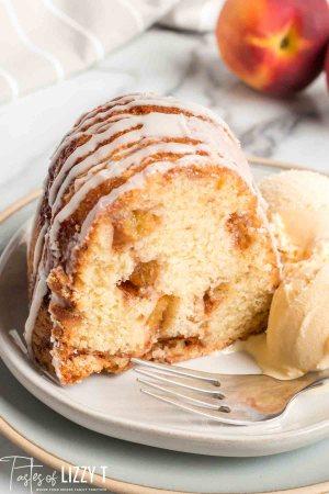 slice of peach swirl bundt cake on a plate