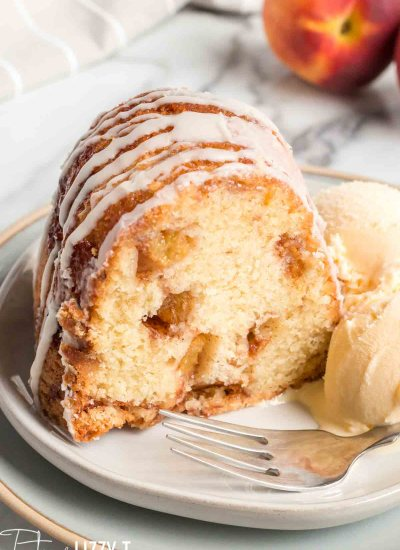 slice of peach swirl bundt cake on a plate