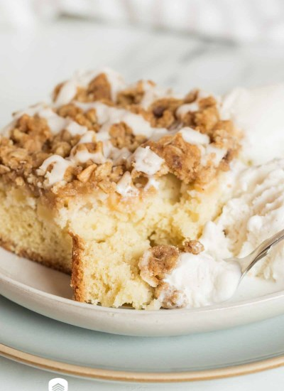 apple crisp coffee cake on a plate with a fork