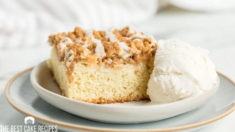 apple crumb cake with ice cream on a plate