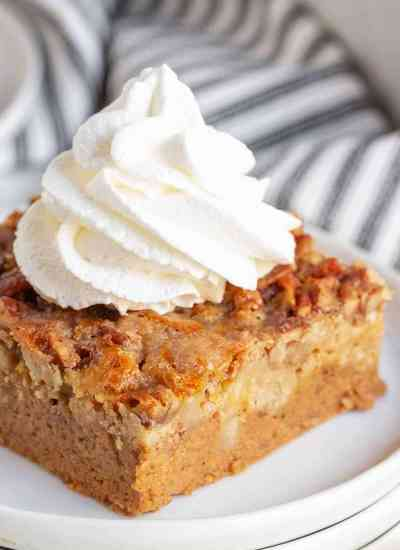 slice of pumpkin cake with whipped cream