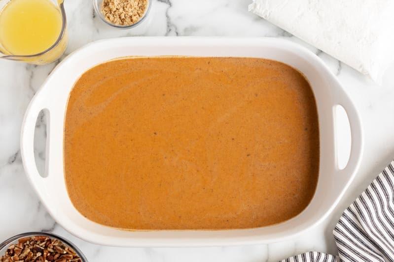 pumpkin filling for cake in baking pan