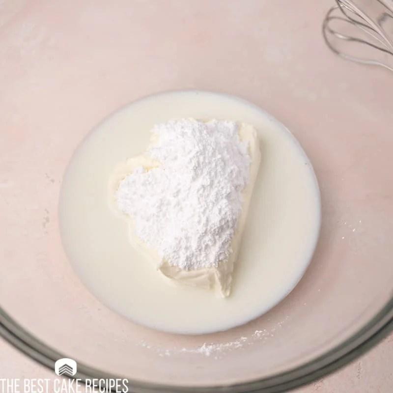 cream cheese, milk and sugar in a bowl