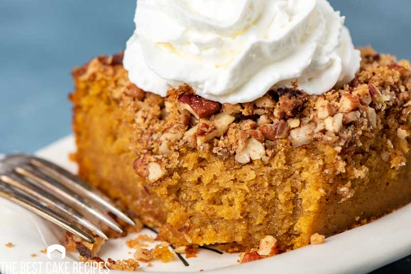 slice of pumpkin cake with a bite out of it