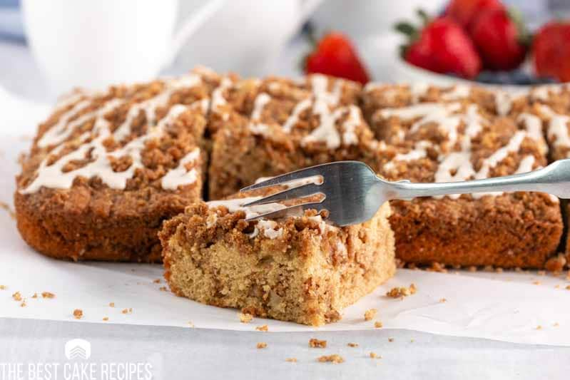 graham cracker coffee cake on a table with a fork