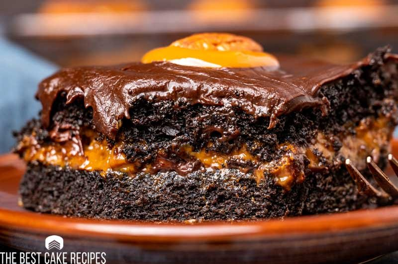 piece of chocolate cake with caramel on a plate