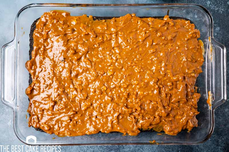 caramel covered chocolate cake in a pan