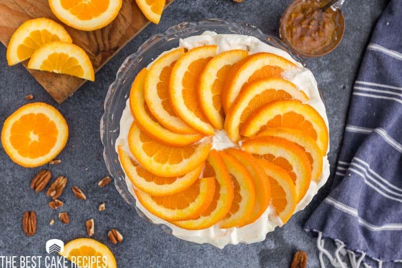overhead view of an orange cake with sliced swirls