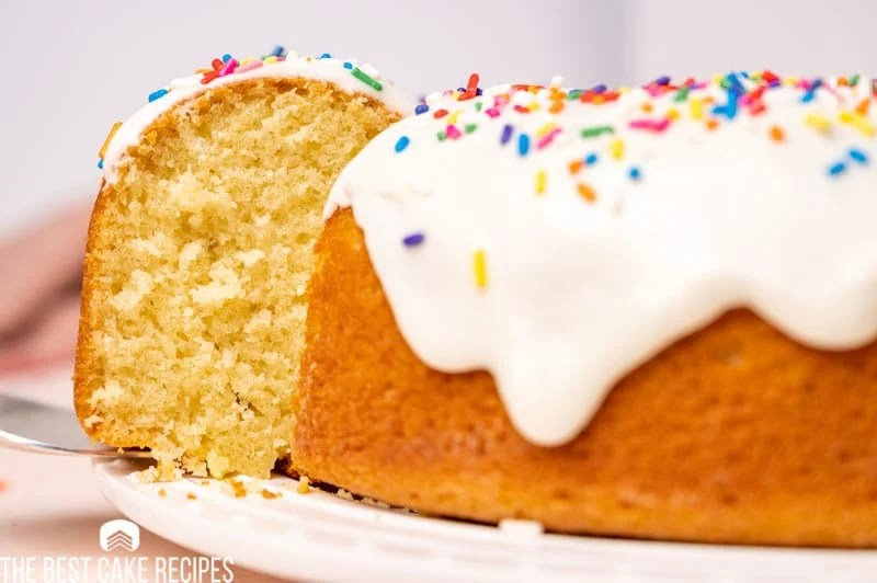 donut bundt cake with a piece on a spatula