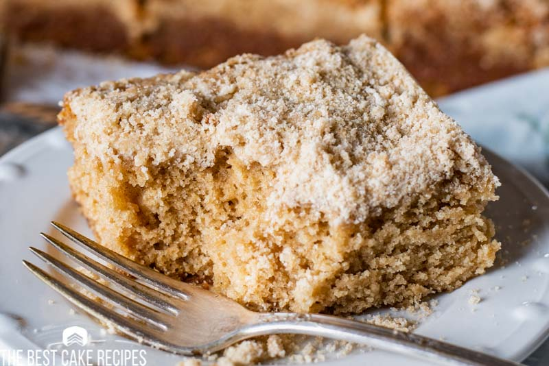 crumb snack cake on a plate with a fork