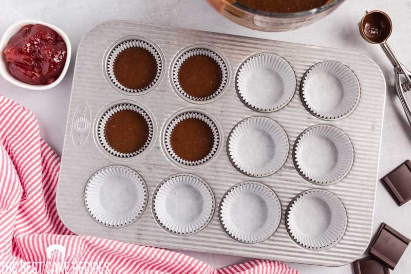 unbaked chocolate cupcakes in a pan