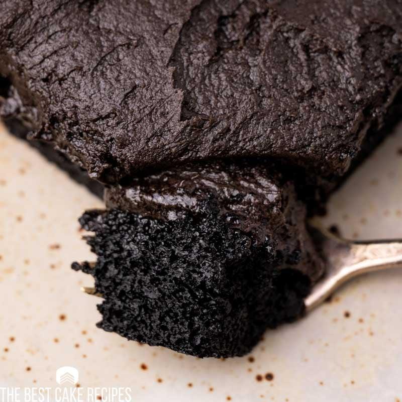 a closeup of a bite of chocolate cake