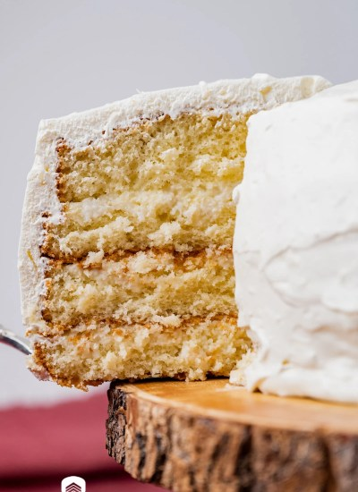 a slice of 3 day coconut cake on a spatula