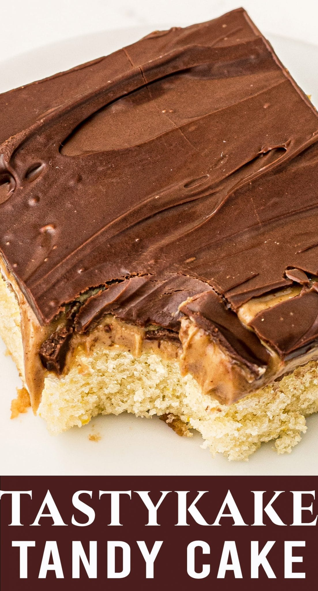 A copycat of the original Tastykake Tandy Cake! Peanut butter and chocolate toppings sit on top of a fluffy white cake. Makes a large sheet cake to serve a crowd. via @thebestcakerecipes