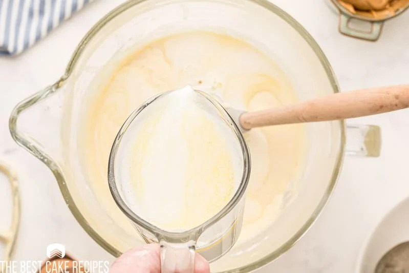 pouring milk and butter into a mixing bowl