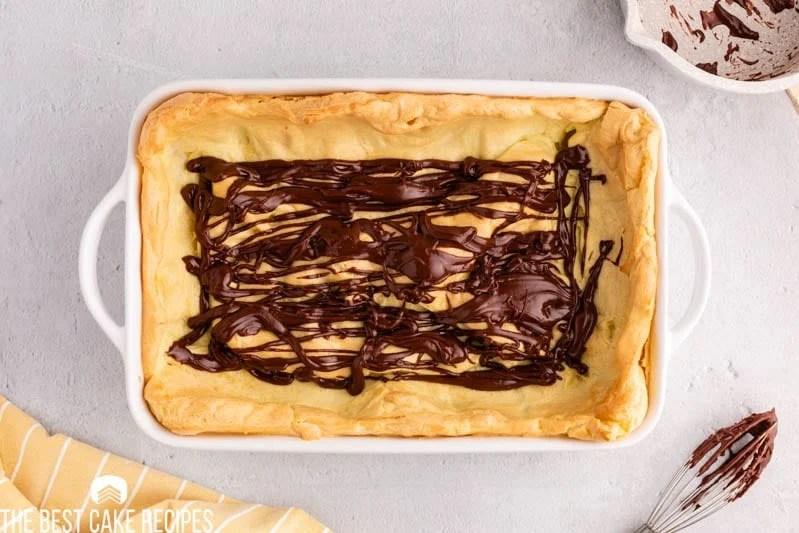 chocolate drizzled over a cream puff crust