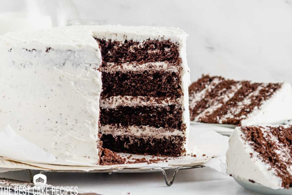 a cake on a table with two slices cut