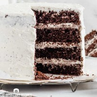 4 layer chocolate cake with white frosting