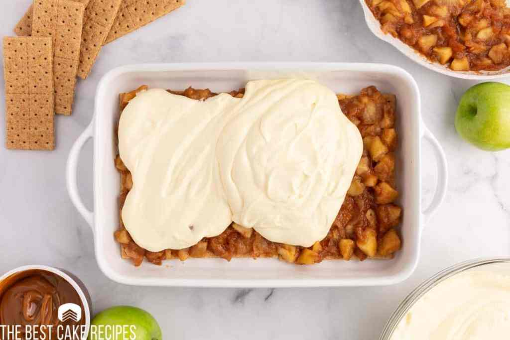 pudding over apple pie filling in a baking dish
